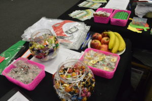 Stand display of fruit, sweets, merchandise